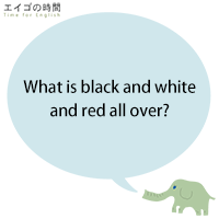 What is black and white and red all over?